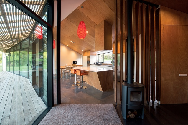 Forms within the house, such as the kitchen island, continue the folded, origami-esque theme.