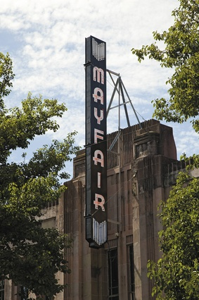 Exterior of the Mayfair theatre with art deco signage.