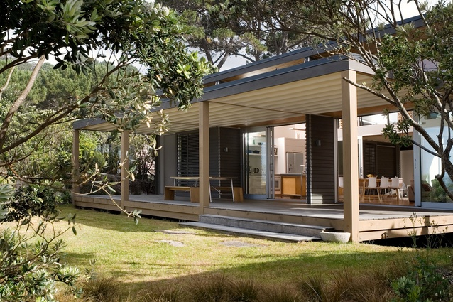Whangapoua Bach, built in 2008. This simple bach sits lightly on the sand dunes, with most of the living and entertaining taking place on two large verandahs.