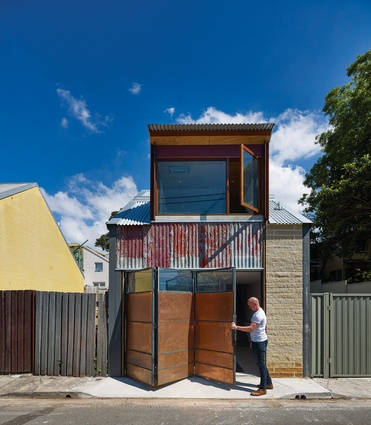 The studio fronts a rear laneway; a pivoting screen works as a garage door or a privacy/ventilation screen, depending on how the space is used.
