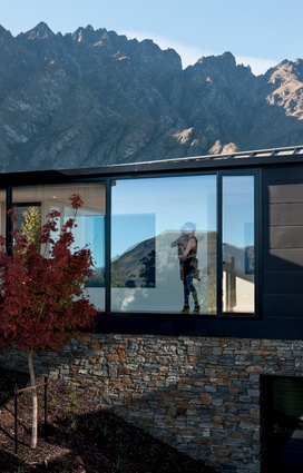 Full-height windows offer spectacular views into the landscape.