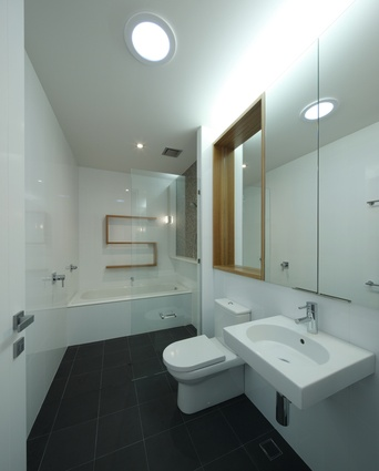 The bathrooms are designed to look clean and minimal.