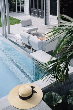 The inviting azure waters of the above-ground pool. Modular seating from Citta Design's Pop outdoor furniture.