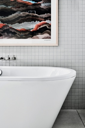 Generous-sized bathtubs invite you to soak and relax.