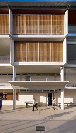 N°3 Timber elements screen the upper alcoves, adding warmth to the exterior of the building.