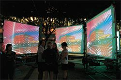 "A circle of screens formed a ""room"" for the viewers to experience each of the video installations. Shown here is m3architecture's Chemside Theatre."