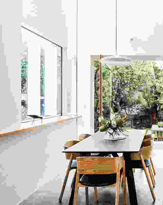 """A glazed """"snorkel,"""" formed from the steeply vaulted ceiling, floods the kitchen and dining space with sunlight."""