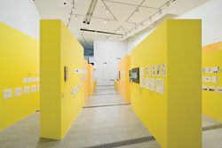 "The aisles of yellow, ""like oversized yellow trace"", form the backdrop for the sketches and notes of Lab Architecture Studio at the Ian Potter Centre, NGV."