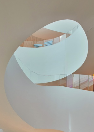 The spiral, emblematic of progress, is used throughout the building to evoke optimism and inspire hope.