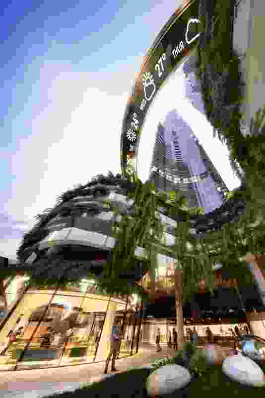 A curved bridge with large LED screens on the underside will link the two Orion towers by Woods Bagot.