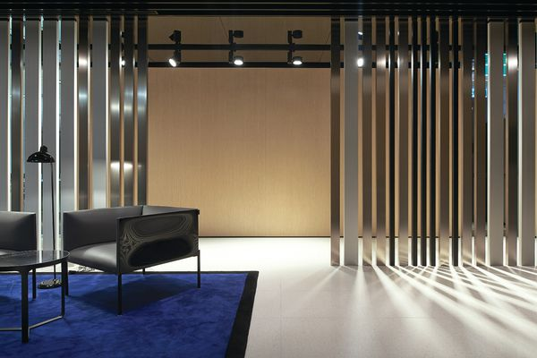 Taking the form of a barcode, aluminium screens in three finish tones enclose public areas.