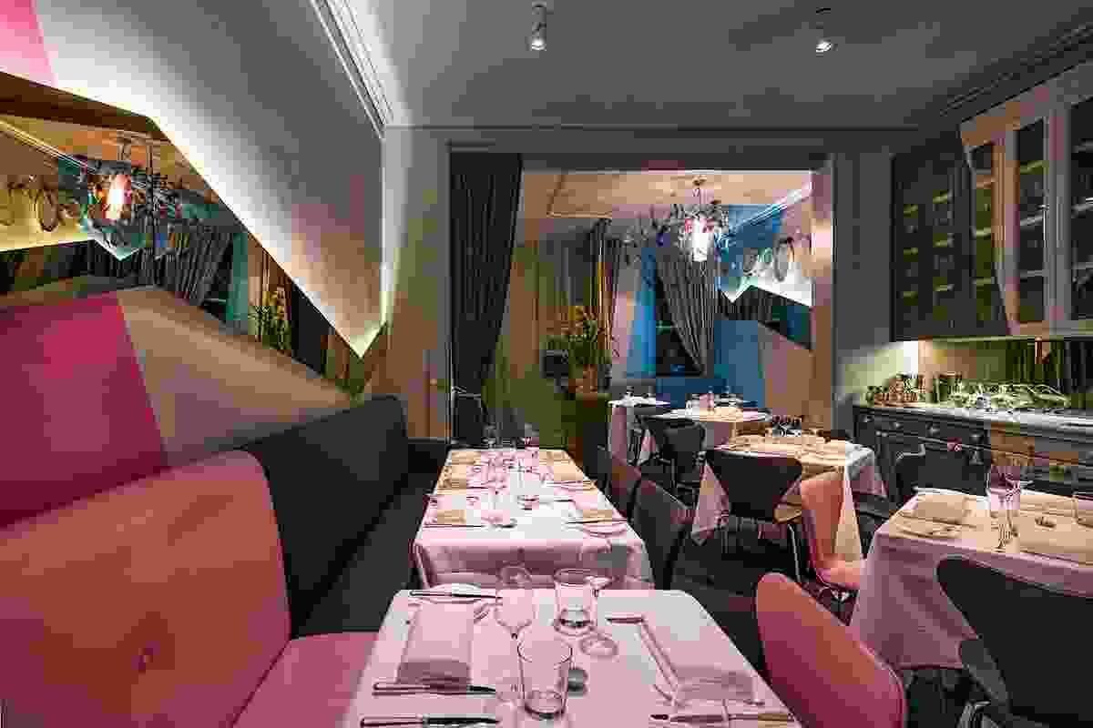 The coloured graphics cut through walls,  upholstery and furniture.