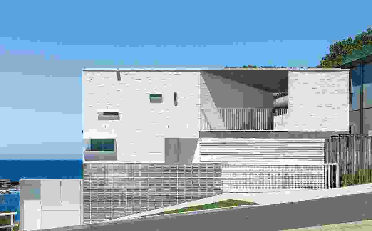 The language and palette of GB House transposes ancient courtyard architecture onto a seaside site.