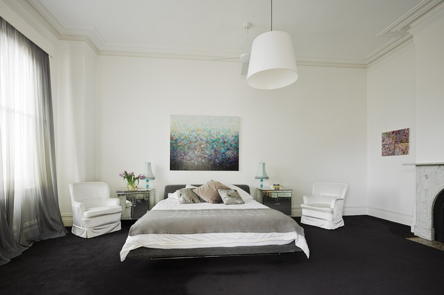 The generously sized main bedroom uses a clean, simple aesthetic. Artwork: Matthew Johnson, Christine Abrahams Gallery.