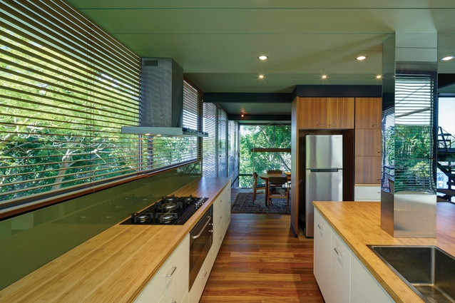 Internal finishes have been refreshed, with the semi-enclosed kitchen modernized and opened to the dining spaces.