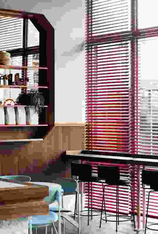 Wine-coloured venetian blinds span the store's front windows and have also been used in Caravan's other venues.