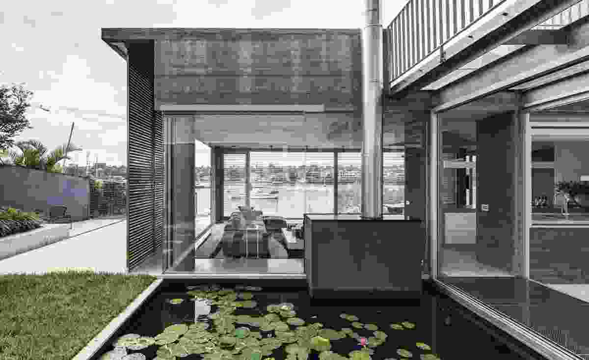 Link House is a pavilion surrounded by terraces and gardens that open the home to the sun, air and water. Photograph: Murray Fredericks.