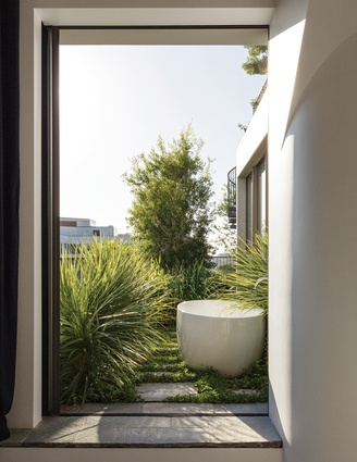 An outdoor bath provides an opportunity for reprieve and relaxation amongst the garden.