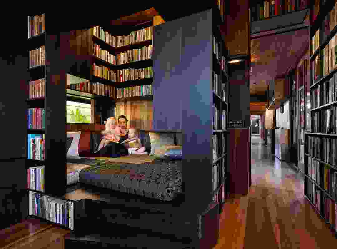 A book-lined daybed in the library offers a contained space in which to retreat.