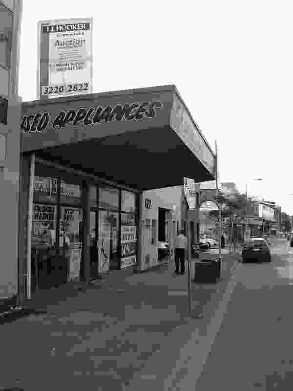 The shopfront as it appeared in 2008, prior to restoration.
