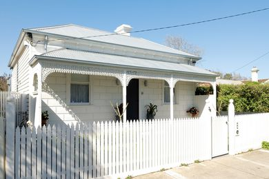 The extension sits behind the classic bullnose facade of this 1860s Victorian cottage in Williamstown.