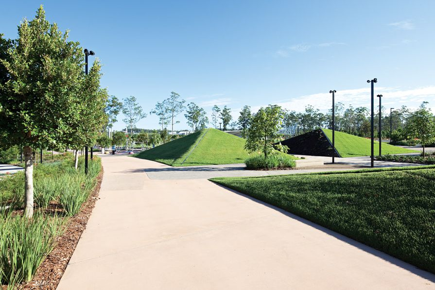 Pyramidal lawns provide visual interest as well as a place for kids to play.