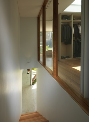 A modern staircase leads from the rear extension of the Annandale House by CO-AP Architects back to the main house.