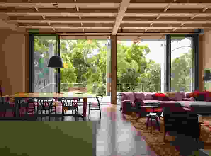 In the main living space, 3.9-metre-high doors open to the north, admitting light and air.