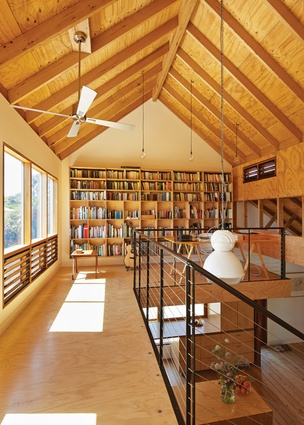 A mezzanine study and bedrooom are located on the uppermost level.