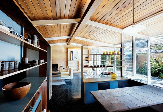 The single gable roof and expansive plate glass windows make for breezy interiors befitting a coastal location.