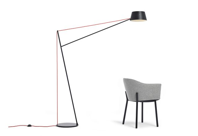 The Spar floor light by Jamie McLennan is inspired by the masts of sailing boats and the upholstered form of the Felix Chair by Simon James contrasts with an industrial-style base.