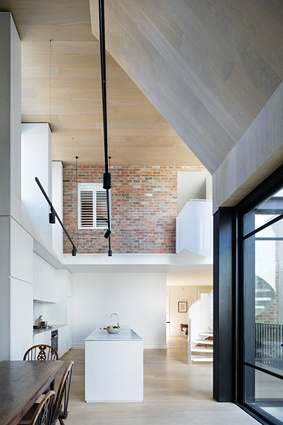 The architects favoured the drama of a double-height living space over additional floor space on the upper level.