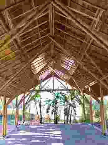 An interior view of the Amway Hlu bamboo structure and woven bamboo ceiling lining.