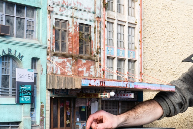 """In <I>Urban Decay</I>, miniaturist Joshua Smith depicts """"overlooked"""" buildings from across Sydney, including the Karim Building on Wentworth Avenue, the Olympia Milk Bar on Parramatta Road, and the Chinese Ginsengs and Herbs Co. building in Haymarket."""