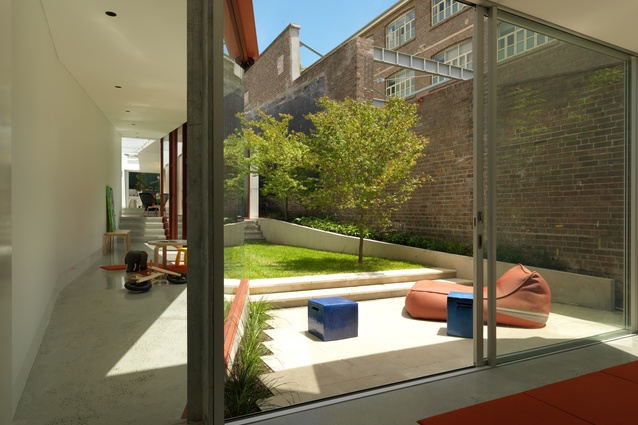 """Rather than """"going wide"""" across the site, the extension to the Annandale House by CO-AP Architects has narrow space but each is complemented by its own outdoor space."""