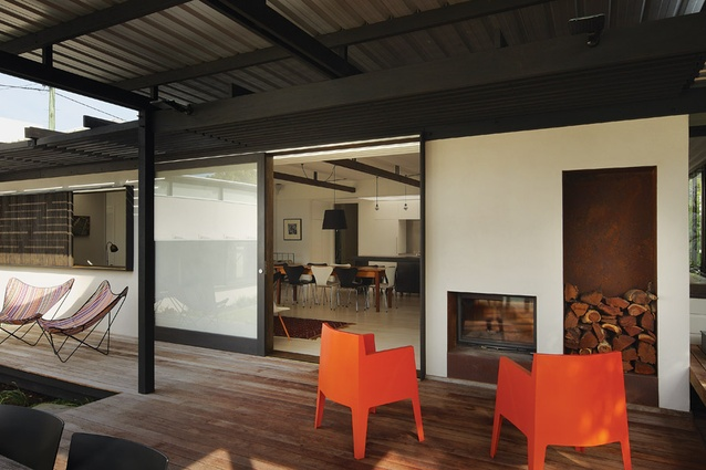 A double-sided fireplace in the Chelmer House adds heat to outdoor rooms and strengthens indoor-outdoor connections.