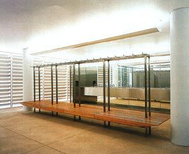 Changing rooms, with light filtered through the metallic brise-soleil that wraps the building.