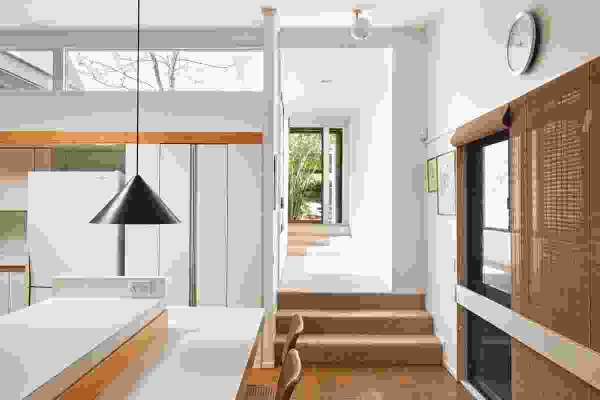 The kitchen, at the centre of the house, receives sunlight bouncing in from the courtyards.