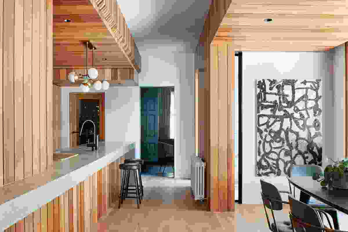 The American oak joinery, in situ concrete benchtops and custom brass sinks will take on a patina as they age. Artwork: Patrick Dagg.