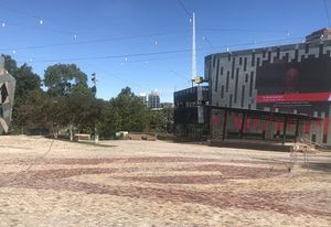 "At a deserted Federation Square in Melbourne, the big screen broadcasts this message: ""If you can see this, what are you doing? Go home."""