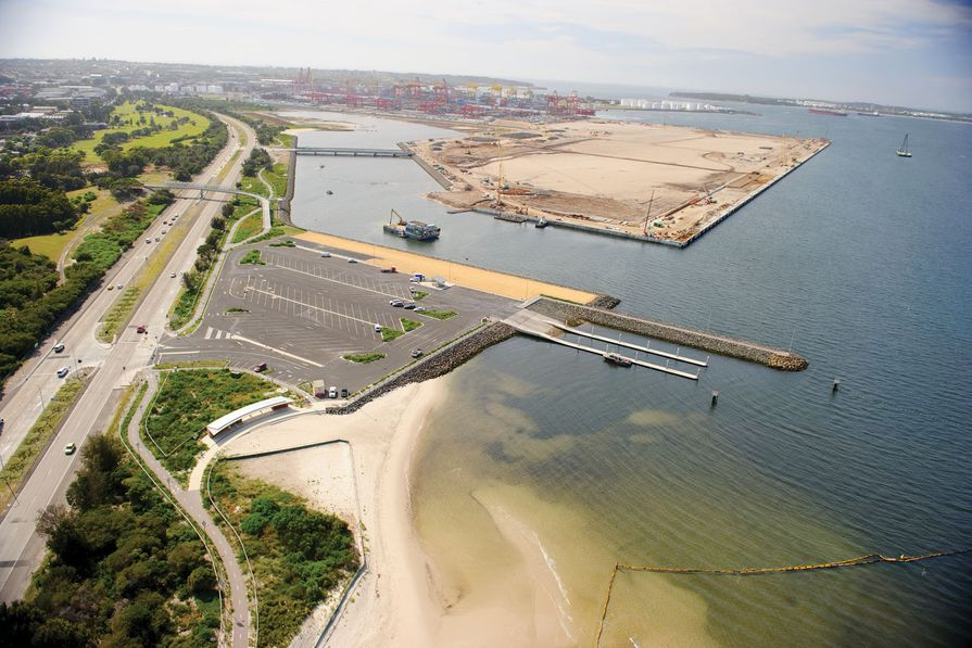 An aerial shot of the Port Botany expansion project, overlooking the boat ramp, pedestrian overpass and port terminal.