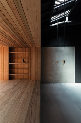 A timber box contains the living platform in the Kyoto Terrace House by Atelier Luke.