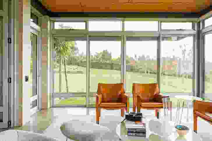 Full-height glazing in the sunroom makes the most of the impressive views of the surrounding landscape.
