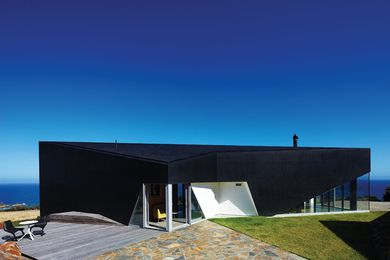 As a black object in the landscape, the house has gravitas beyond its size.