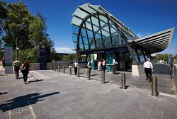 The entry pavilions, at ground level, provide the external public face of the underground stations. Macquarie University Station is shown here.