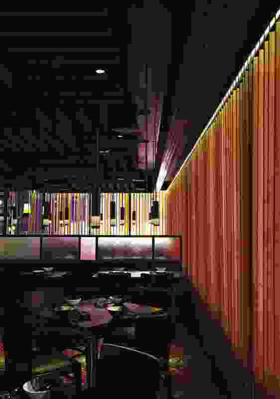 Noise in Spice Temple's main dining area is softened by an acoustic timber curtain.