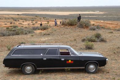 Mungo Man's remains arrived home in a 1976 black Chrysler Valiant hearse.