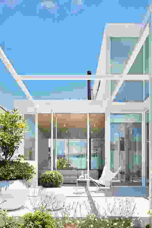 A central courtyard, open to the sky, both connects and separates the house's tripartite layout.