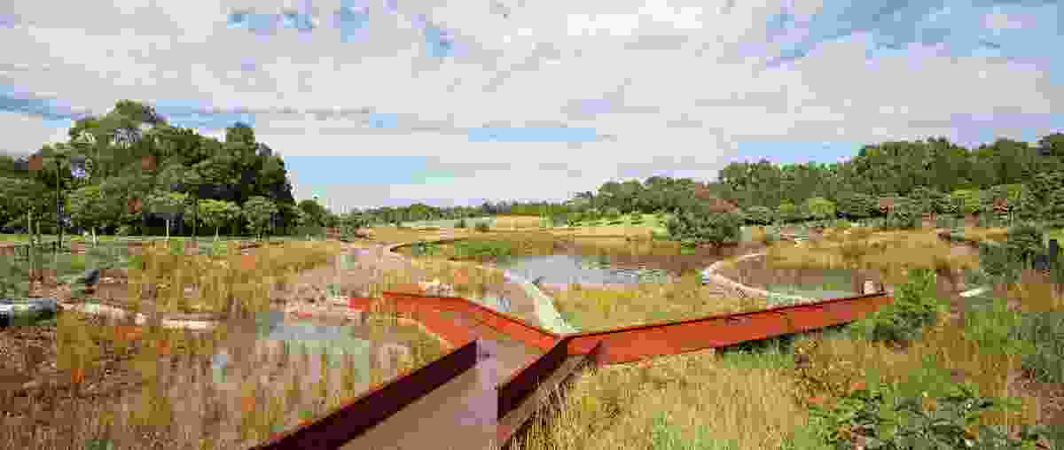 A bifurcated Corten steel viaduct is calibrated according to the capacity of each of the two bioretention beds it delivers water to.