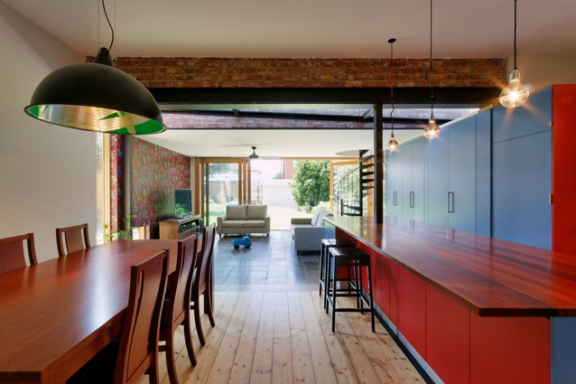 The lack of cohesion is emphasized and enjoyed in the open-plan living/dining/kitchen areas.